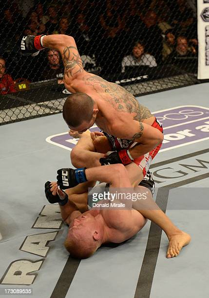 Cub Swanson punches Dennis Siver in their featherweight fight during the UFC 162 event inside the MGM Grand Garden Arena on July 6, 2013 in Las...