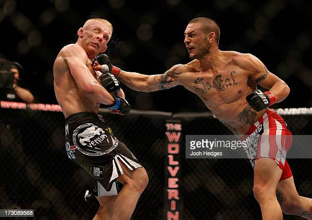 Cub Swanson punches Dennis Siver in their featherweight fight during the UFC 162 event inside the MGM Grand Garden Arena on July 6 2013 in Las Vegas...