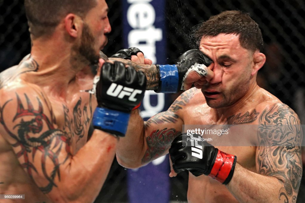 Cub Swanson punches Frankie Edgar in their featherweight fight during the UFC Fight Night event at the Boardwalk Hall on April 21, 2018 in Atlantic City, New Jersey.
