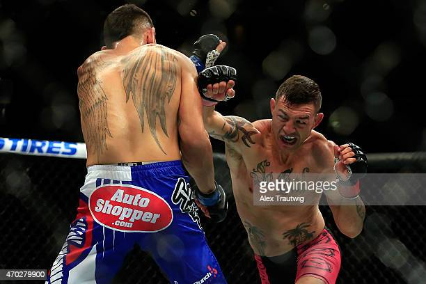Cub Swanson punches Max Holloway in their featherweight bout during the UFC Fight Night event at Prudential Center on April 18 2015 in Newark New...