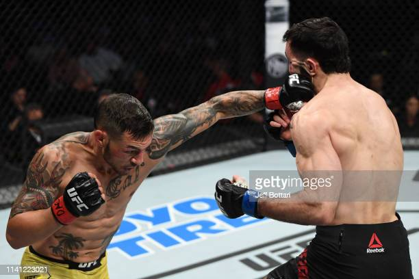 Cub Swanson punches Shane Burgos in their featherweight bout during the UFC Fight Night event at Canadian Tire Centre on May 4 2019 in Ottawa Ontario...