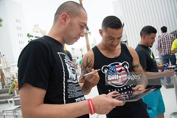 Cub Swanson signs autographs for fans during the Foxtail pool party at SLS Las Vegas during UFC International Fight Week on July 9 2015 in Las Vegas...