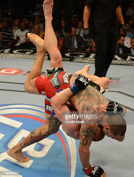 Cub Swanson slams Dennis Siver in their featherweight fight during the UFC 162 event inside the MGM Grand Garden Arena on July 6, 2013 in Las Vegas,...
