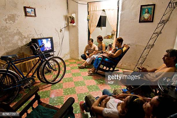 Cuba Camaguey Family Watching Tv At Home