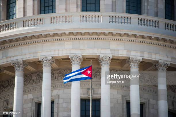 cuba flag at el capitolio in havana - cuban flag stock pictures, royalty-free photos & images