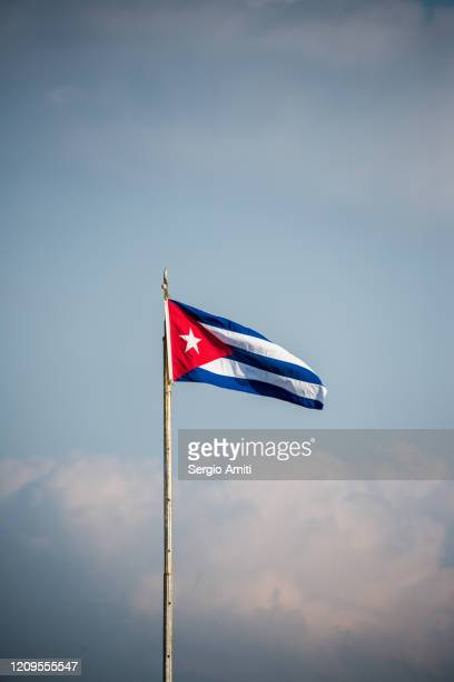 cuba flag on a pole in havana - cuban flag stock pictures, royalty-free photos & images