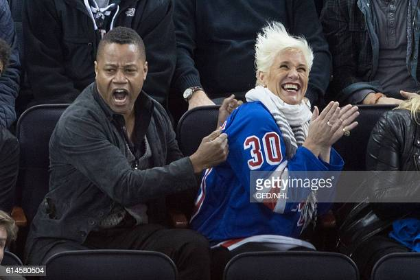 Cuba Gooding Jr and Anne Burrell attends New York Islanders Vs New York Islanders game at Madison Square Garden on October 13 2016 in New York City