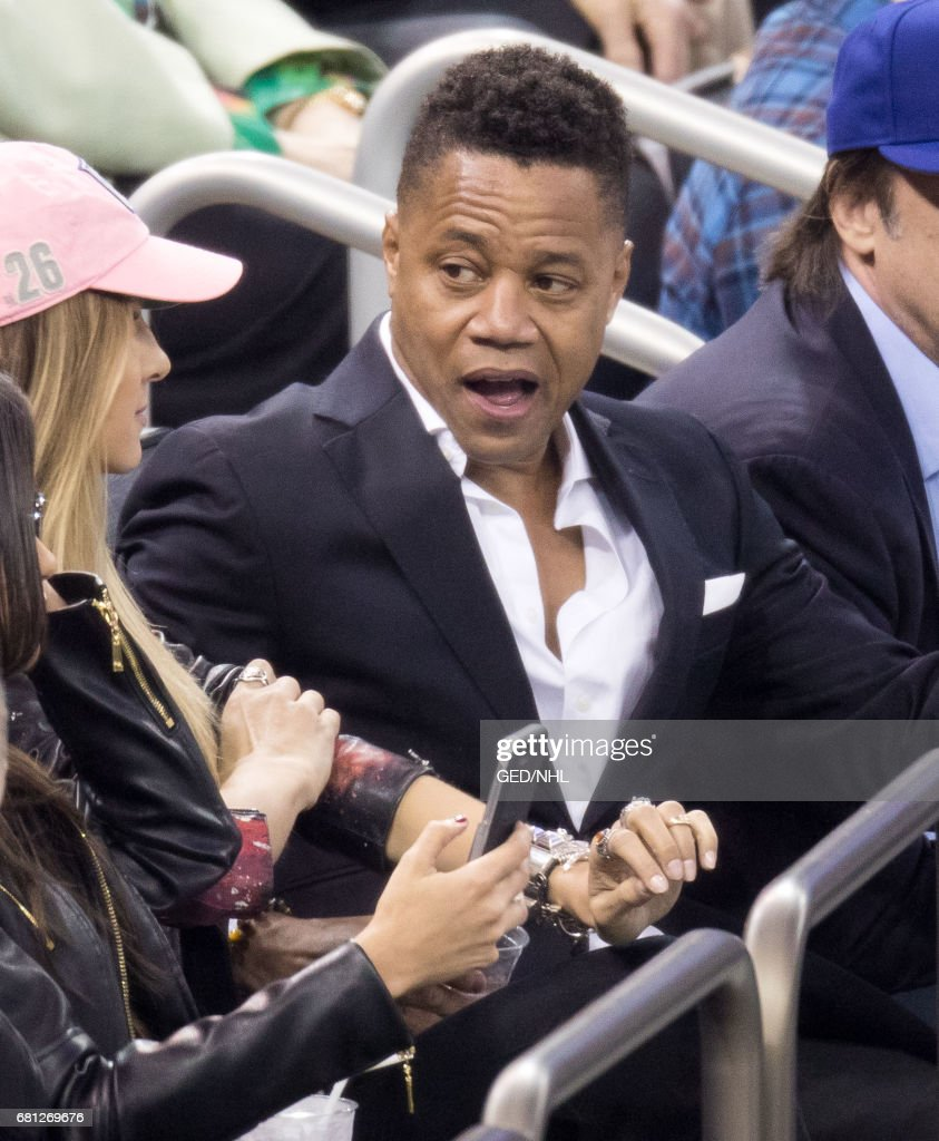 Cuba Gooding, Jr. and Ashley Haas attend Ottawa Senators Vs. New York Rangers 2017 Playoff Game on May 9, 2017, at Madison Square Garden in New York City.