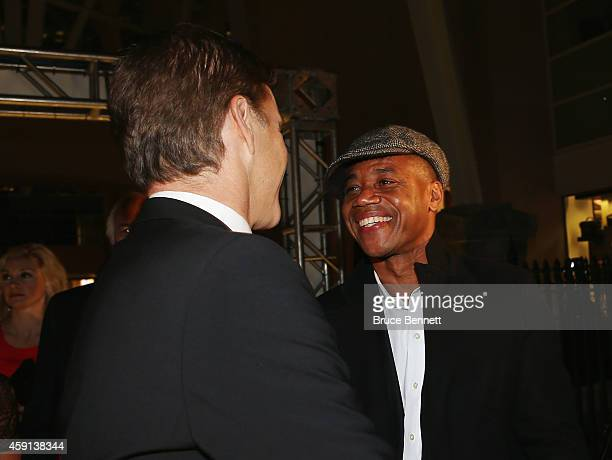 Cuba Gooding Jr and Luc Robitaille meet on the red carpet prior to the induction ceremony at the Hockey Hall of Fame on November 17 2014 in Toronto...