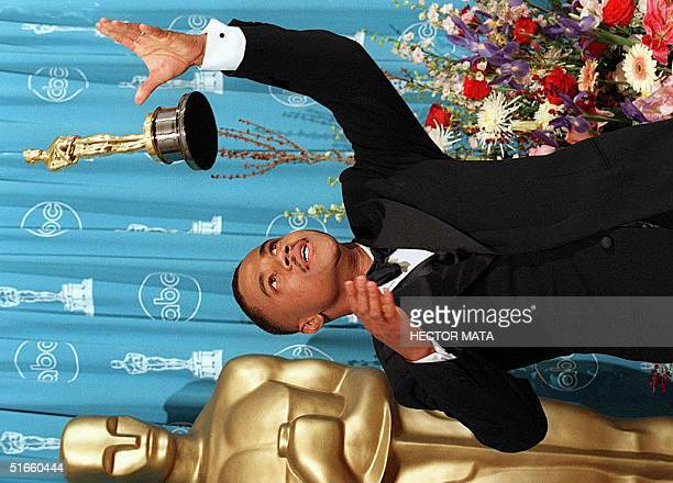 Cuba Gooding Jr throws his Oscar into the air as he poses for the press after he was nominated Best Supporting Actor for his role in Jerry Maguire...