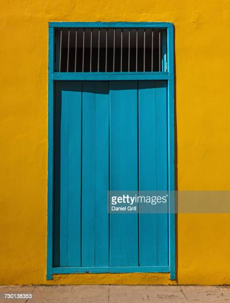 Cuba, Havana, Building exterior with blue door