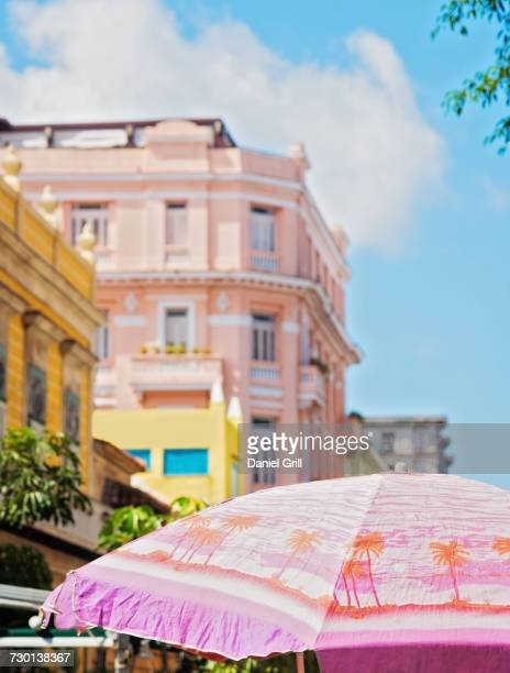 Cuba, Havana, Colonial architecture and sunshade in foreground
