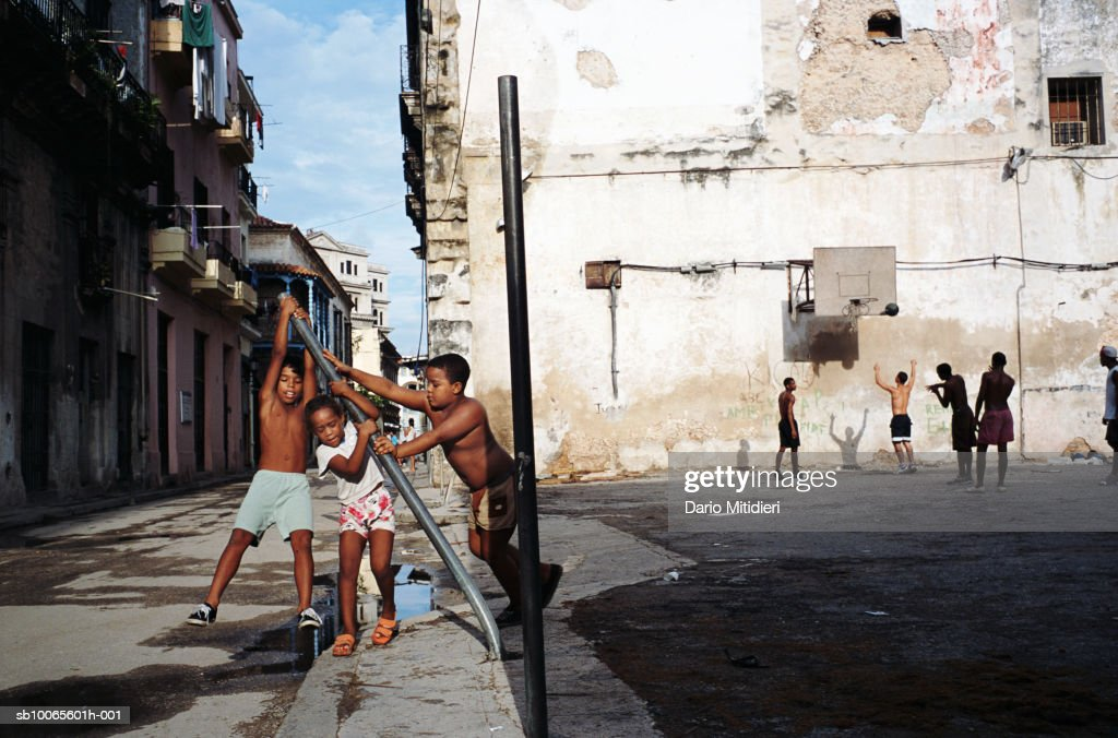 Cuba, Havana, Plaza de la Revolution, boys (8-10) playing on street