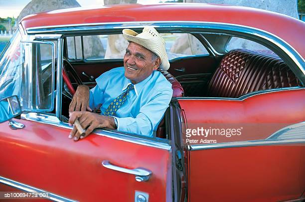 Cuba, havana, Senior man stepping out of car, portrait