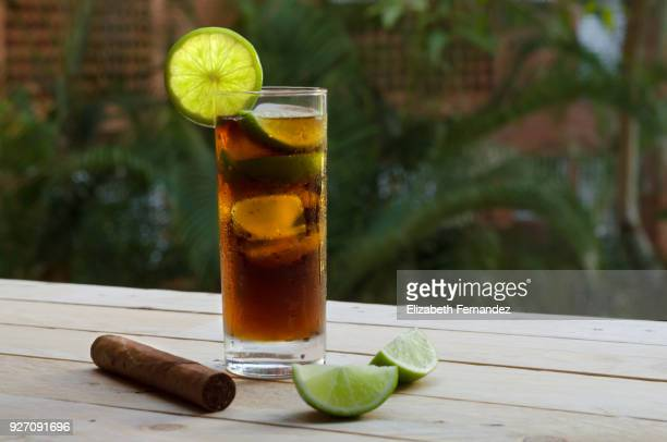 cuba libre and fine cuban cigar - rum stock pictures, royalty-free photos & images