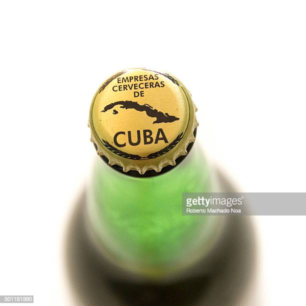 Cuba made products Branding on lid of Bruja beer bottle with the words empresas cerveceras de cuba and a map of Cuba Cuba is famous for its beverages...