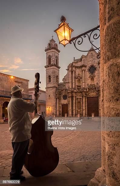 Cuba. Man playing double bass.