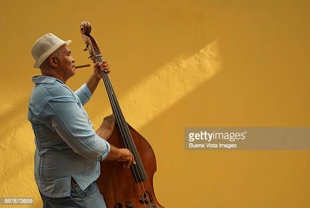 Cuba. Man playing double bass.
