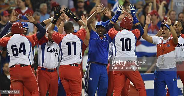 Cuba National baseball team celebrate with high fives for Alfredo Despaigne Yander Luis La O and Yulieski Gurriel after scoring over the Venezuela...