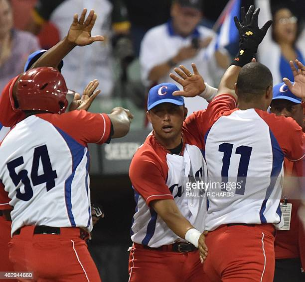 Cuba National baseball team celebrate with high fives for Alfredo Despaigne Yander Luis La O after scoring over the Venezuela National baseball team...