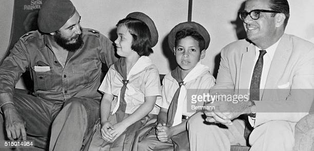 Cuba Premier Fidel Castro and Cuban President Osvaldo Dorticos chat with Margarita Gomez and Julio Fernandez charter members of the Union of Rebel...
