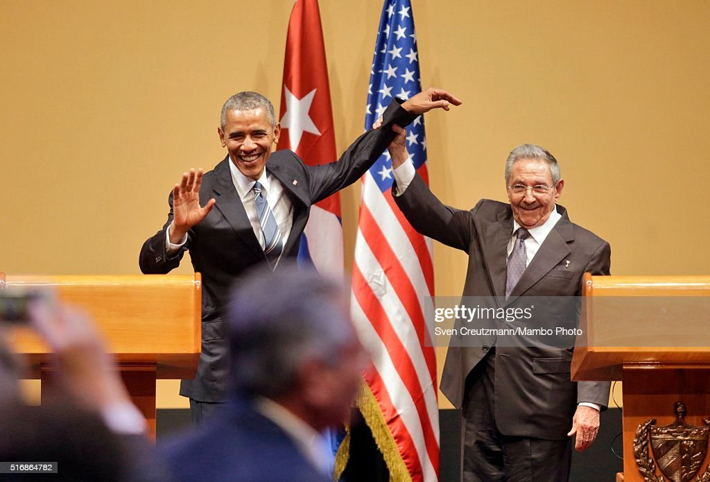 Cuba President Raul Castro (R) lifts the arm of U.S. President Barack Obama at the end of a joint press conference at the Cuban State Council, on March 21, 2016 in Havana, Cuba. Mr. Obama, who is on a 48 hour trip to Cuba, is the first sitting U.S. President to visit Cuba in almost 90 years.