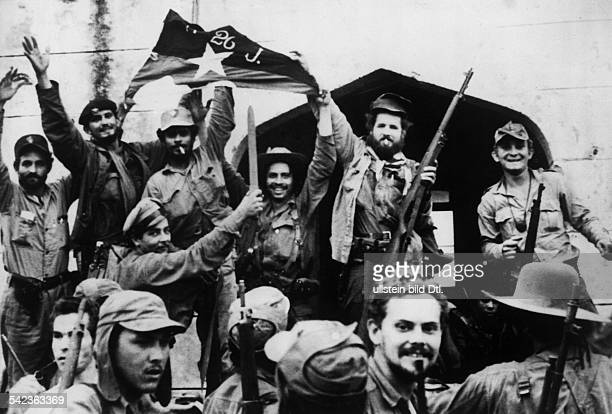 Cuba Revolution 1958/59 Cuban revolutionists capture the town of Fomento| they are waving their symbol the 'Flag of July 26'