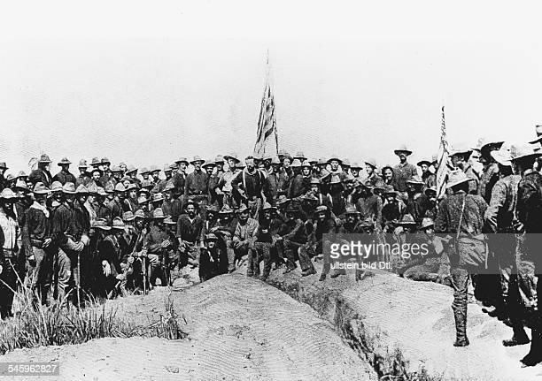 Cuba Spanish-American War Colonel Theodore Roosevelt with the Rough Riders on captured San Juan Hill. - July 1898