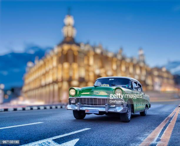 cuba taxi vintage car in the center of old havana at night - havana stock pictures, royalty-free photos & images