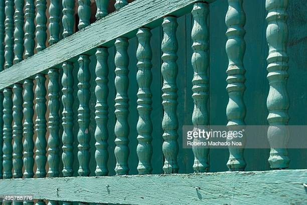 Cuba tourism Close up of antique colonial style barrotes or grill on window in Sancti Spiritus Cuba These barrotes are made of wood and are being...