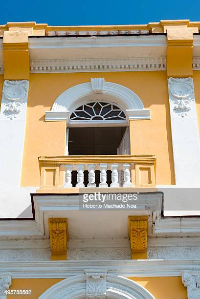 Cuba tourism Colonial architecture in Sancti Spiritus Rectangular balcony with opening topped by well designed arch and side columns on the facade of...
