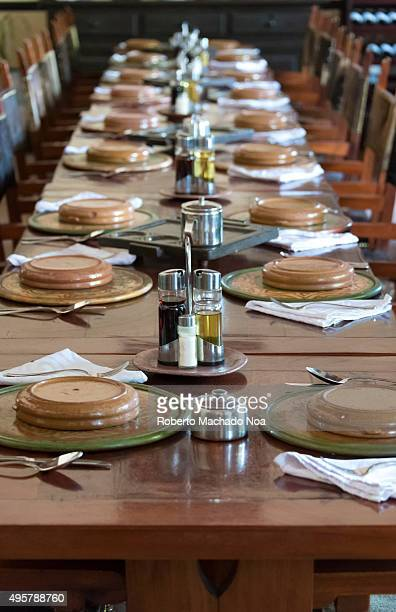 Cuba tourism Long dining table arranged at a restaurant in Sancti Spiritus Cuba Dining table neatly arranged for a big group