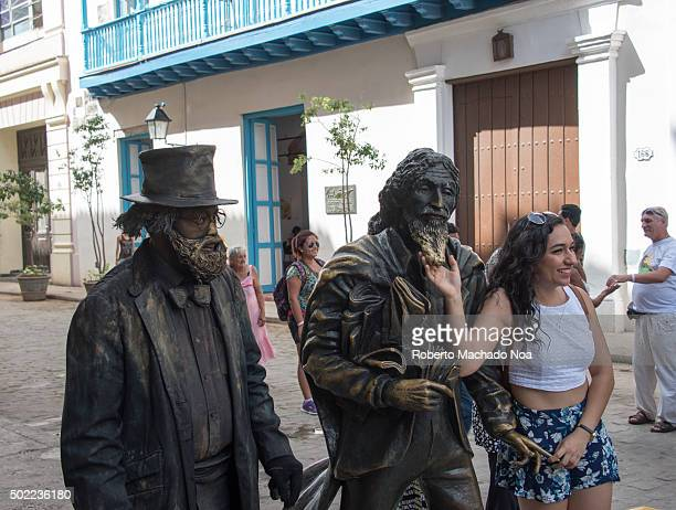 Cuba tourism the Knight of Paris or El Caballero de Paris sculpture in Old Havana Cuba In the image there is a living statue at the left and a woman...
