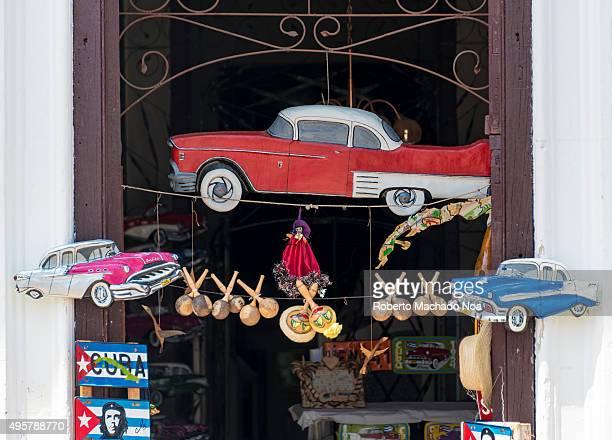 Cuba tourism Toys and Cuban Souvenirs for sale at a shop in Sancti Spiritus Cuba