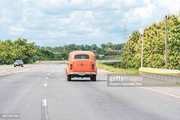 Cuba transport Old vintage cars in the National Highway travelling at an approximate 100km/h Due to the lack of imports Cubans have become experts at...