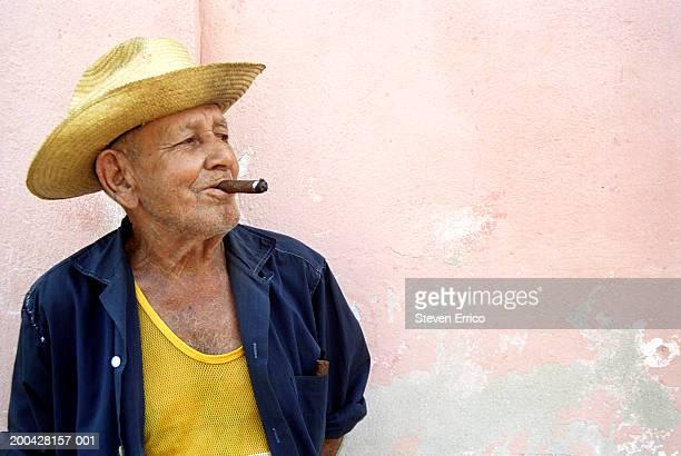 Cuba, Trinidad, senior man smoking cigar, looking away