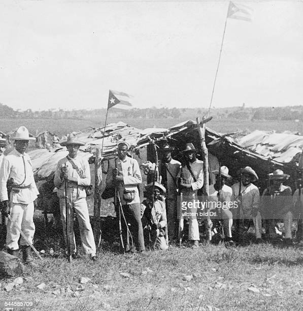 Cuba War of Independence 189598 Cuban soldiers bivouacking near Guanabacoa| the Cuban flag is hanging on the mast 1898