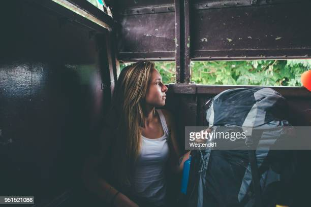 cuba, young woman with backpack traveling on a van - rucksacktourist stock-fotos und bilder