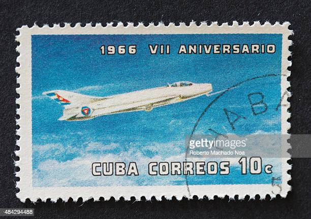 Cuban 10 cent stamp depicting an aeroplane flying in the blue sky Cuba correos VII Aniversario 1966 The stamp marks the 7th anniversary of the cuban...