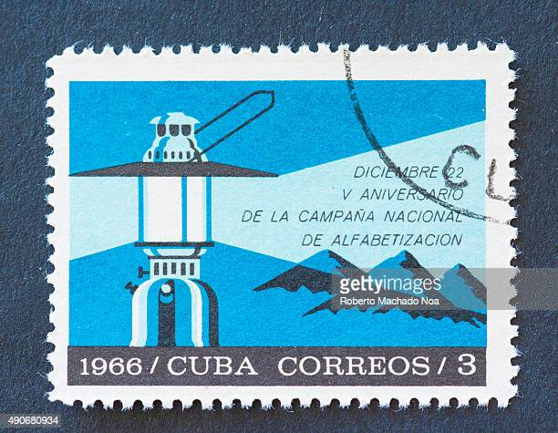 Cuban 1966 stamp commemorating the 5th anniversary of the National campaign on literacy The stamp shows a lantern and mountains in the background