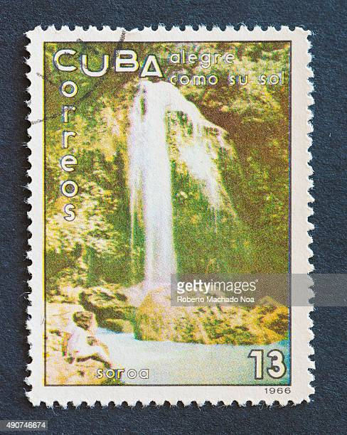 Cuban 1966 stamp on 'alegre como su sol' series depicting people at a waterfall in Soroa Soroa also called as the 'rainbow of Cuba' is a mountain...