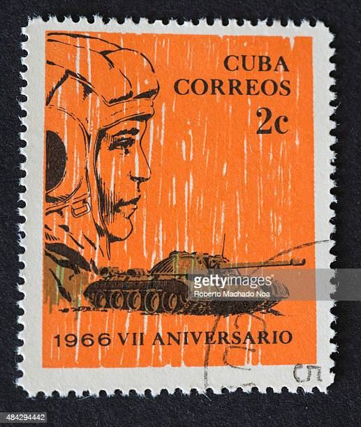Cuban 2 cent stamp depicting a battle tank and the face of a soldier Cuba Correos VII Aniversario 1966 The stamp marks the 7th anniversary of the...