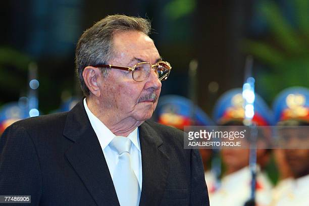 Cuban acting President Raul Castro reviews the guard of honor 24 October 2007 at the Revolution Palace, in Havana during a military ceremony to...