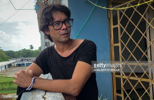 Cuban actor, playwright and opposition activist Yunior Garcia Aguilera gestures during an interview with AFP on October 13, 2021 at his home in...