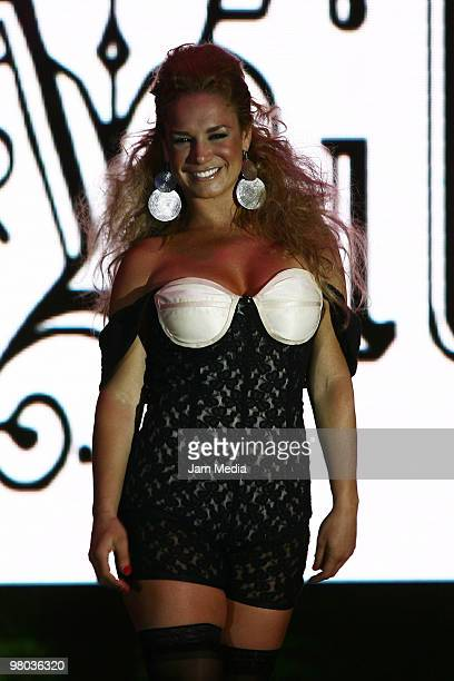 Cuban actress Liz Vega walks the runway during the fashion show of Mexican designer Artemiza Cruz for La Vill on March 24 2010 in Mexico City Mexico