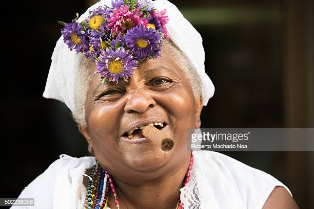 Caribbean People: Black Woman Smoking Cigar Stock Photos And Pictures