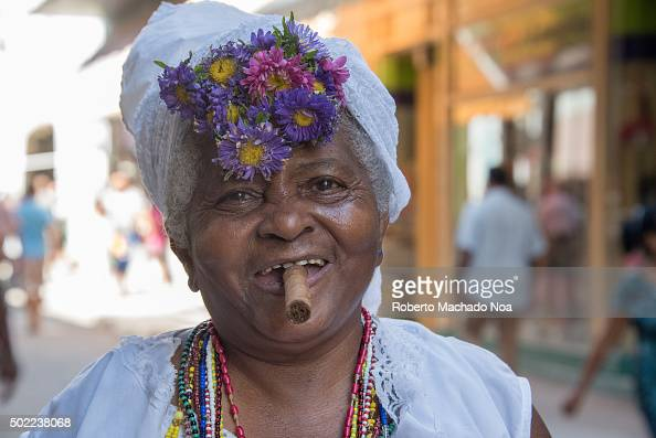 Caribbean People: Woman Dressed In Afro Religious Clothing And Accessories