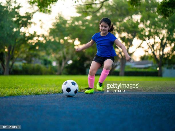 cuban american girl soccer practice in the park - sports league stock pictures, royalty-free photos & images