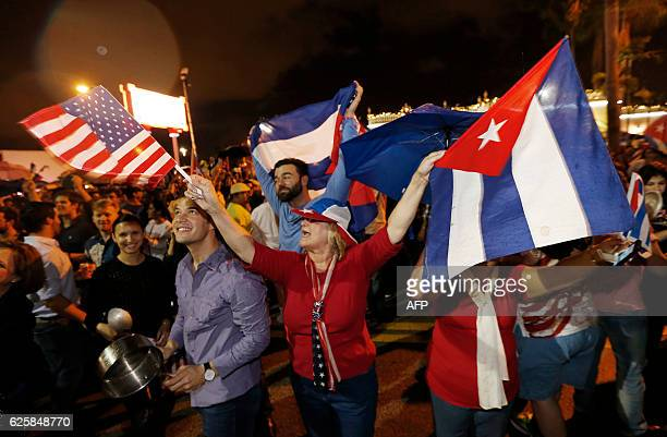 TOPSHOT Cuban Americans celebrate upon hearing about the death of longtime Cuban leader Fidel Castro in the Little Havana neighborhood of Miami...
