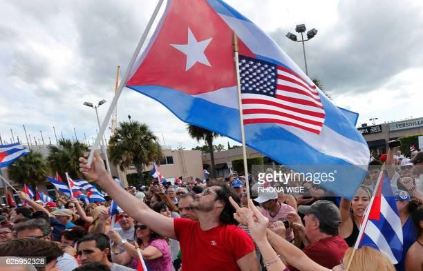 TOPSHOT Cuban Americans in Miami's Little Havana celebrate the death of longtime Cuban leader Fidel Castro on November 26 2016 Cuba's socialist icon...